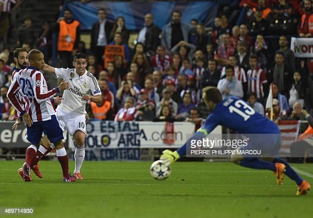 Real Madrid's Colombian midfielder James Rodriguez vies with Atletico Madrid's Brazilian defender Joao Miranda and Atletico Madrid's Slovenian...