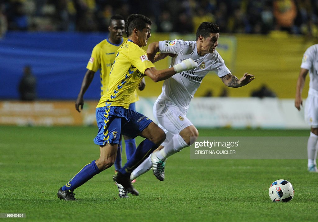 Real Madrid's Colombian midfielder James Rodriguez vies with Cadiz's midfielder Jon Ander during the Spanish Copa del Rey football match Cadiz CF vs...