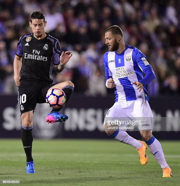 Real Madrid's Colombian midfielder James Rodriguez vies with Leganes's defender Tito during the Spanish league football match Club Deportivo Leganes...