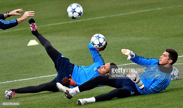Real Madrid's Costa Rican goalkeeper Keylor Navas and Real Madrid's goalkeeper Ruben Yanez train with the goalkeeper coach during a training session...