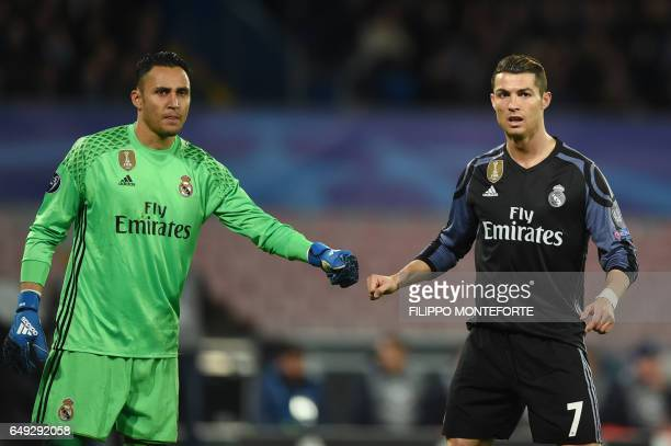 Real Madrid's Costa Rican goalkeeper Keylor Navas and Real Madrid's Portuguese forward Cristiano Ronaldo during the UEFA Champions League football...