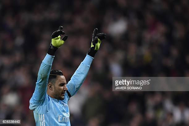 Real Madrid's Costa Rican goalkeeper Keylor Navas celebrates a goal during the UEFA Champions League football match Real Madrid CF vs Borussia...