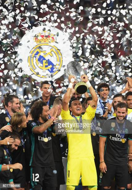 Real Madrid's Costa Rican goalkeeper Keylor Navas holds the trophy after winning the UEFA Super Cup football match between Real Madrid and Manchester...