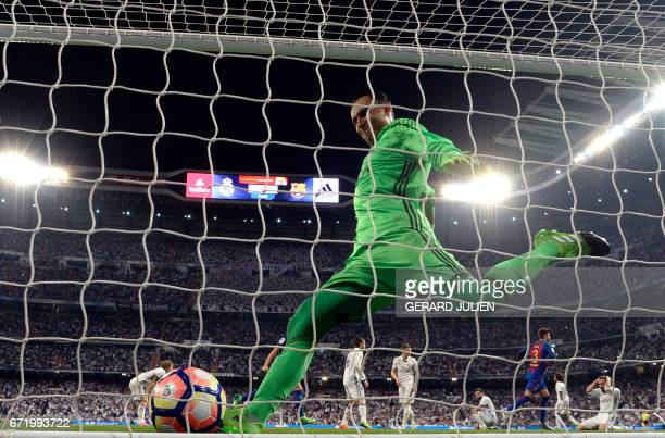 Real Madrid's Costa Rican goalkeeper Keylor Navas kicks the ball after conceding a goal during the Spanish league football match Real Madrid CF vs FC...