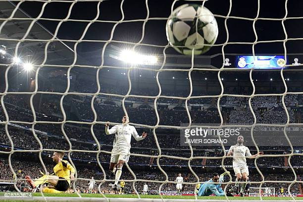 Real Madrid's Costa Rican goalkeeper Keylor Navas looks at the ball after Dortmund's midfielder Marco Reus' goal during the UEFA Champions League...