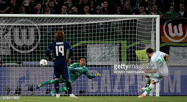 Real Madrid's Costa Rican goalkeeper Keylor Navas misses a penalty kick from Wolfsburg's Swiss defender Ricardo Rodriguez during the UEFA Champions...
