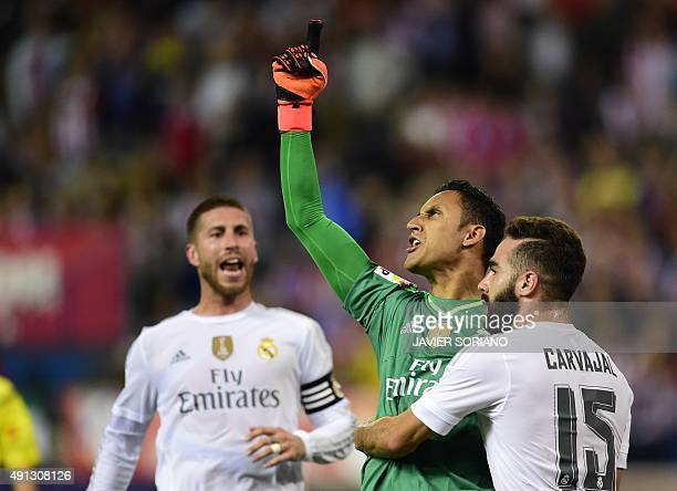 Real Madrid's Costa Rican goalkeeper Keylor Navas reacts after stopping a penalty kick past Real Madrid's defender Dani Carvajal during the Spanish...