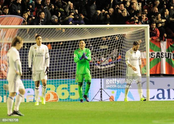 Real Madrid's Costa Rican goalkeeper Keylor Navas shouts to teammates after a goal by Osasuna during the Spanish league football match CA Osasuna vs...