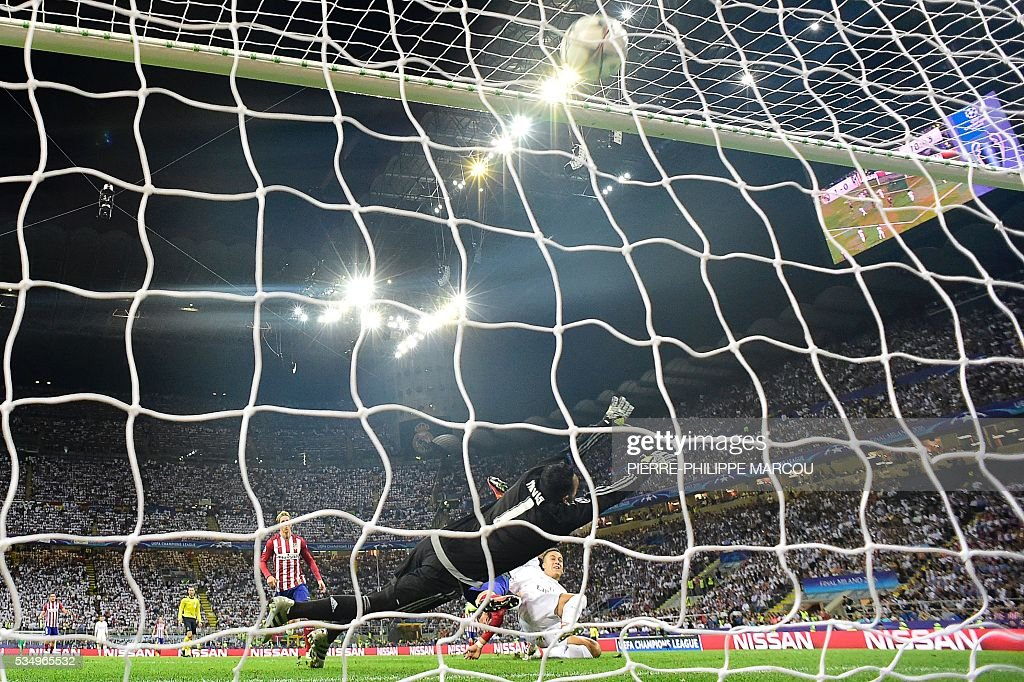 Real Madrid's Costa Rican goalkeeper Keylor Navas tries to stop the ball as Atletico Madrid's Belgian forward Yannick Ferreira Carrasco scored a goal during the UEFA Champions League final football match between Real Madrid and Atletico Madrid at San Siro Stadium in Milan, on May 28, 2016. / AFP / PIERRE