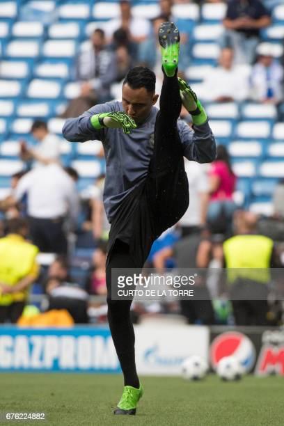CORRECTION Real Madrid's Costa Rican goalkeeper Keylor Navas warms up the UEFA Champions League semifinal first leg football match Real Madrid CF vs...