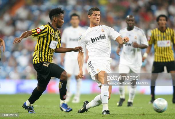 Real Madrid's Cristiano Ronaldo and Al Ittihad's Ahmed Almukhaini