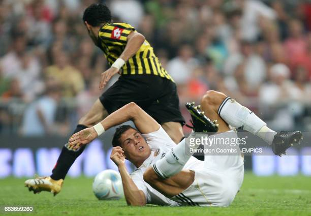 Real Madrid's Cristiano Ronaldo and Al Ittihad's Alsaqri Saleh battle for the ball