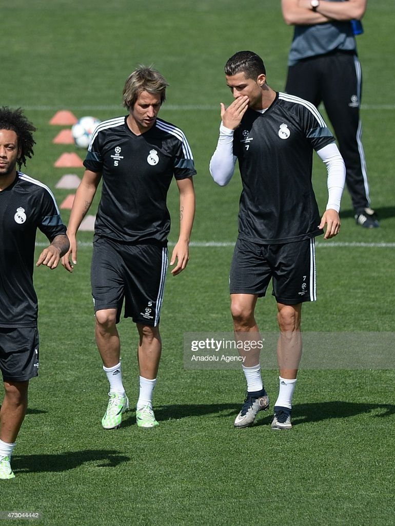 Real Madrid's Cristiano Ronaldo (R) and Fabio Coentrao (2nd R) chat during the pre match training session at Valdebebas training ground in Madrid, Spain on May 12, 2015, ahead of the UEFA Champions League match against Juventus. UEFA Champions League semi final second leg game between Real Madrid and Juventus will be played at Santiago Bernabéu Stadium in Madrid on May 13, 2015.