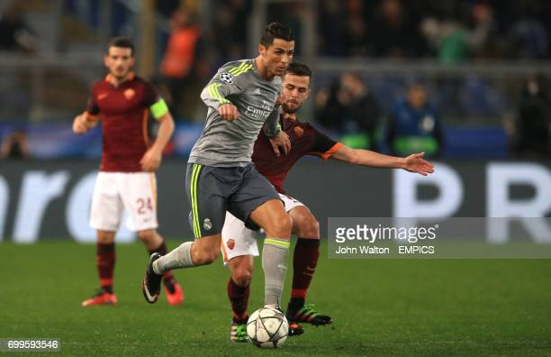 Real Madrid's Cristiano Ronaldo battles for possession of the ball with Roma's Miralem Pjanic