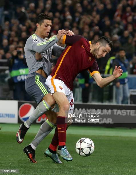 Real Madrid's Cristiano Ronaldo battles for the ball with Roma's Konstantinos Manolas