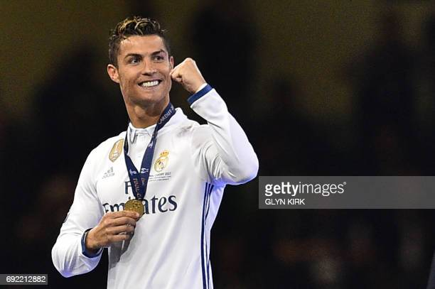 Real Madrid's Cristiano Ronaldo celebrates after Real Madrid won the UEFA Champions League final football match between Juventus and Real Madrid at...