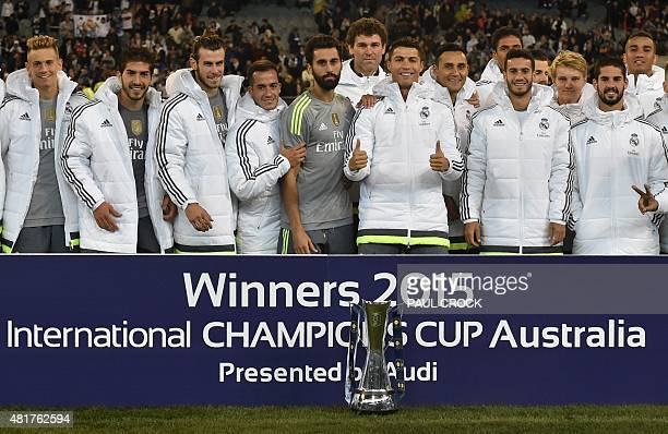 Real Madrid's Cristiano Ronaldo gives the thumbs up as team members celebrate winning the International Champions Cup Australia football match...