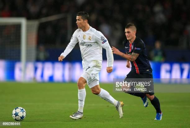 Real Madrid's Cristiano Ronaldo holds off Paris SaintGermain's Marco Verratti