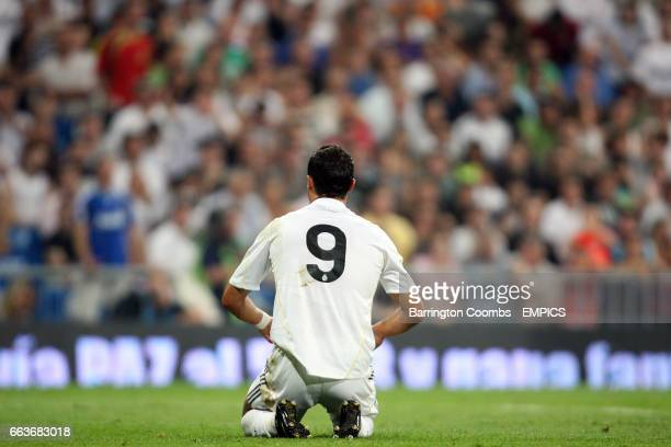 Real Madrid's Cristiano Ronaldo kneels on the pitch with his back towards camera