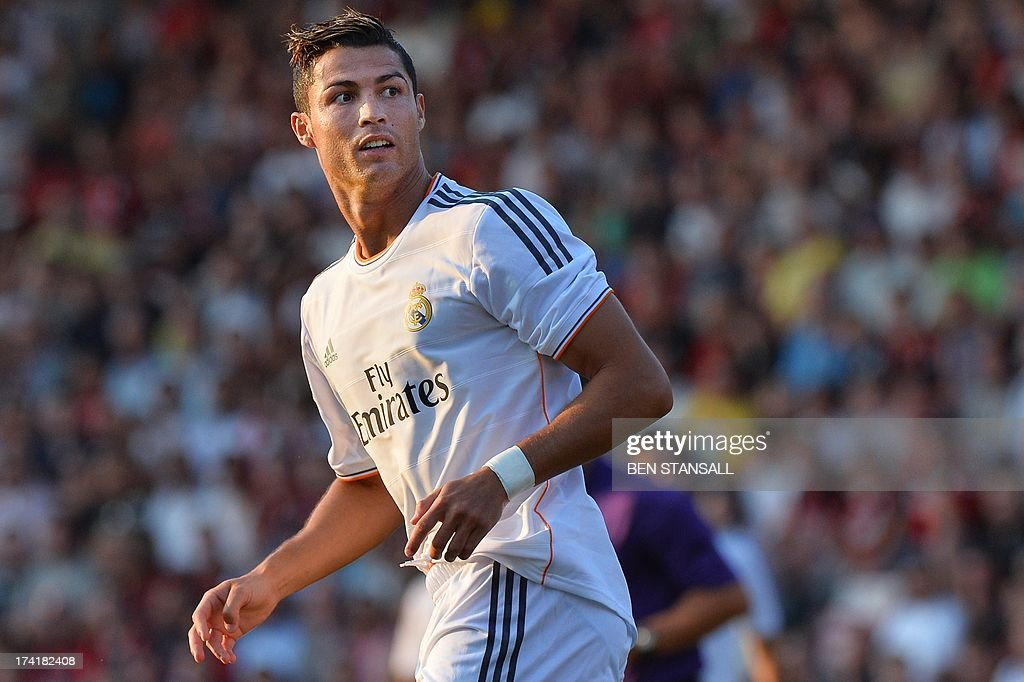 Real Madrid's Cristiano Ronaldo looks on after missing a shot on goal during the pre-season friendly football match between Bournemouth and Real Madrid at the Goldsands Stadium in Bournemouth, England on July 21, 2013.