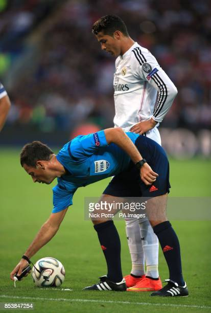 Real Madrid's Cristiano Ronaldo looks on as referee Mark Clattenburg sprays some vanishing spray on the pitch during the UEFA Super Cup Final at the...