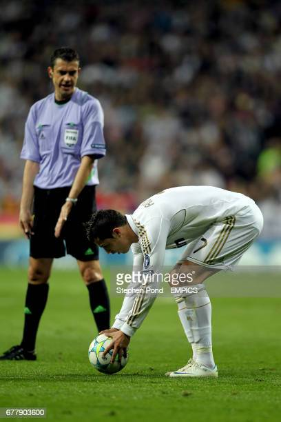 Real Madrid's Cristiano Ronaldo places his free kick watched by referee Viktor Kassai