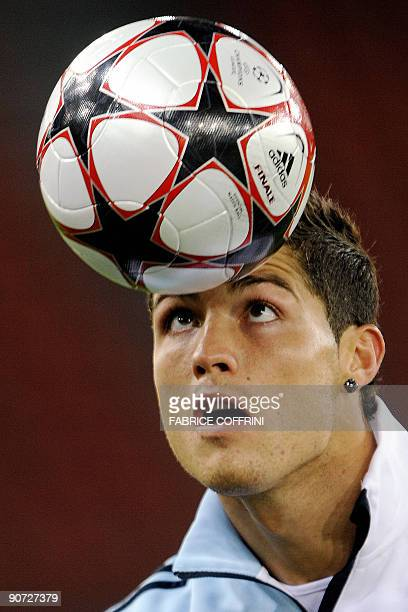 Real Madrid's Cristiano Ronaldo plays with the ball during a training session on the eve of their UEFA Champions league football match against FC...
