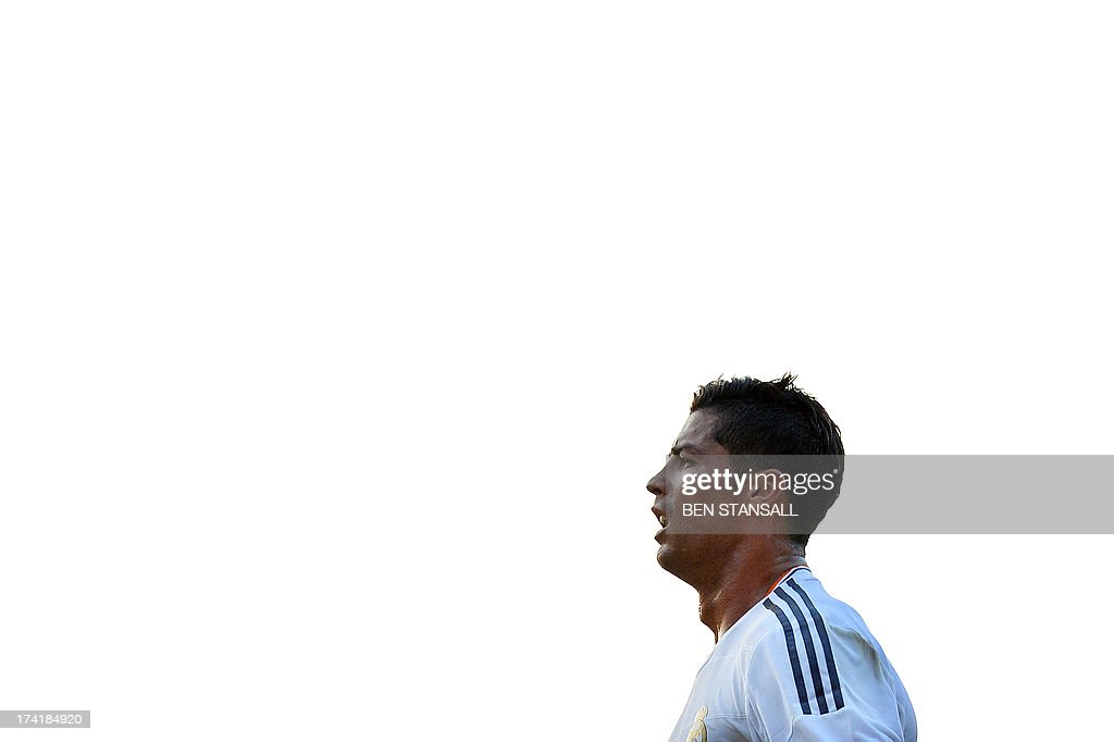 Real Madrid's Cristiano Ronaldo reacts after scoring his second goal during the pre-season friendly football match between Bournemouth and Real Madrid at the Goldsands Stadium in Bournemouth , England on July 21, 2013. AFP PHOTO/BEN STANSALL