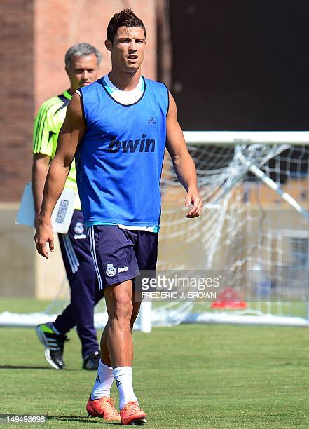 Real Madrid's Cristiano Ronaldo walks past coach Jose Mourinho during a morning training session at UCLA in Los Angeles on July 29 2012 The Spanish...