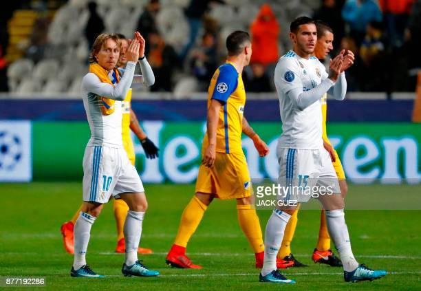 Real Madrid's Croatian midfielder Luka Modric and Real Madrid's French defender Theo Hernandez gesture at the end of the UEFA Champions League Group...