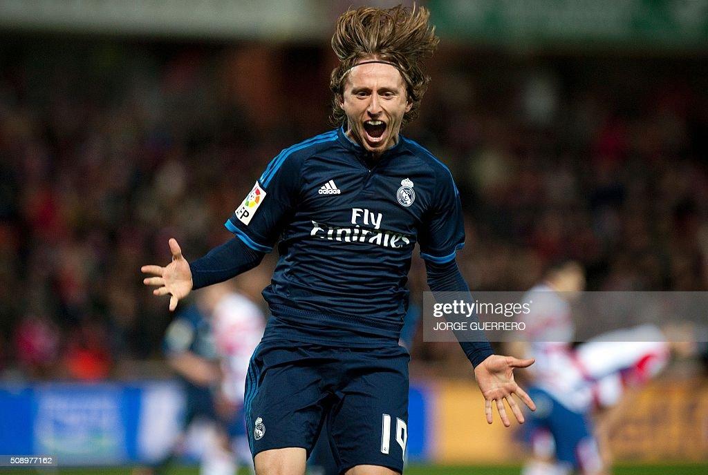 Real Madrid's Croatian midfielder Luka Modric celebrates a goal during the Spanish league football match Granada FC vs Real Madrid CF at Nuevo Los...