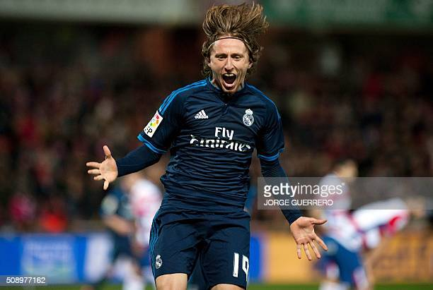 Real Madrid's Croatian midfielder Luka Modric celebrates a goal during the Spanish league football match Granada FC vs Real Madrid CF at Nuevo Los...