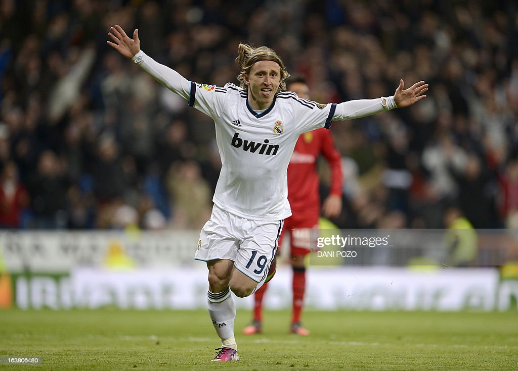 Real Madrid's Croatian midfielder Luka Modric celebrates after scoring during the Spanish League football match Real Madrid CF vs RCD Mallorca at the Santiago Bernabeu stadium in Madrid on March 16, 2013.