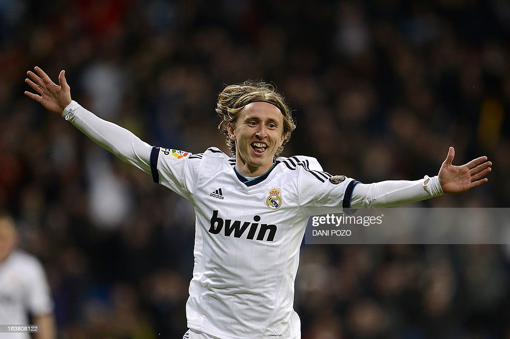 Real Madrid's Croatian midfielder Luka Modric celebrates after scoring during the Spanish League football match Real Madrid CF vs RCD Mallorca at the Santiago Bernabeu stadium in Madrid on March 16, 2013. Real Madrid won 5-2.