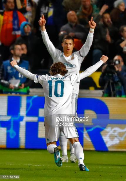 Real Madrid's Croatian midfielder Luka Modric celebrates after scoring with teammate Cristiano Ronaldo during the UEFA Champions League Group H match...