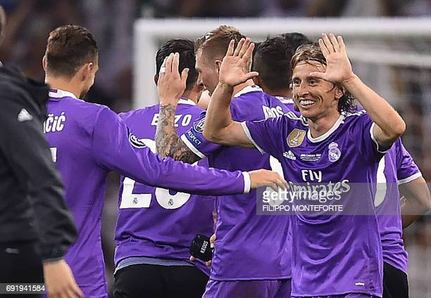 Real Madrid's Croatian midfielder Luka Modric celebrates after winning the UEFA Champions League final football match between Juventus and Real...