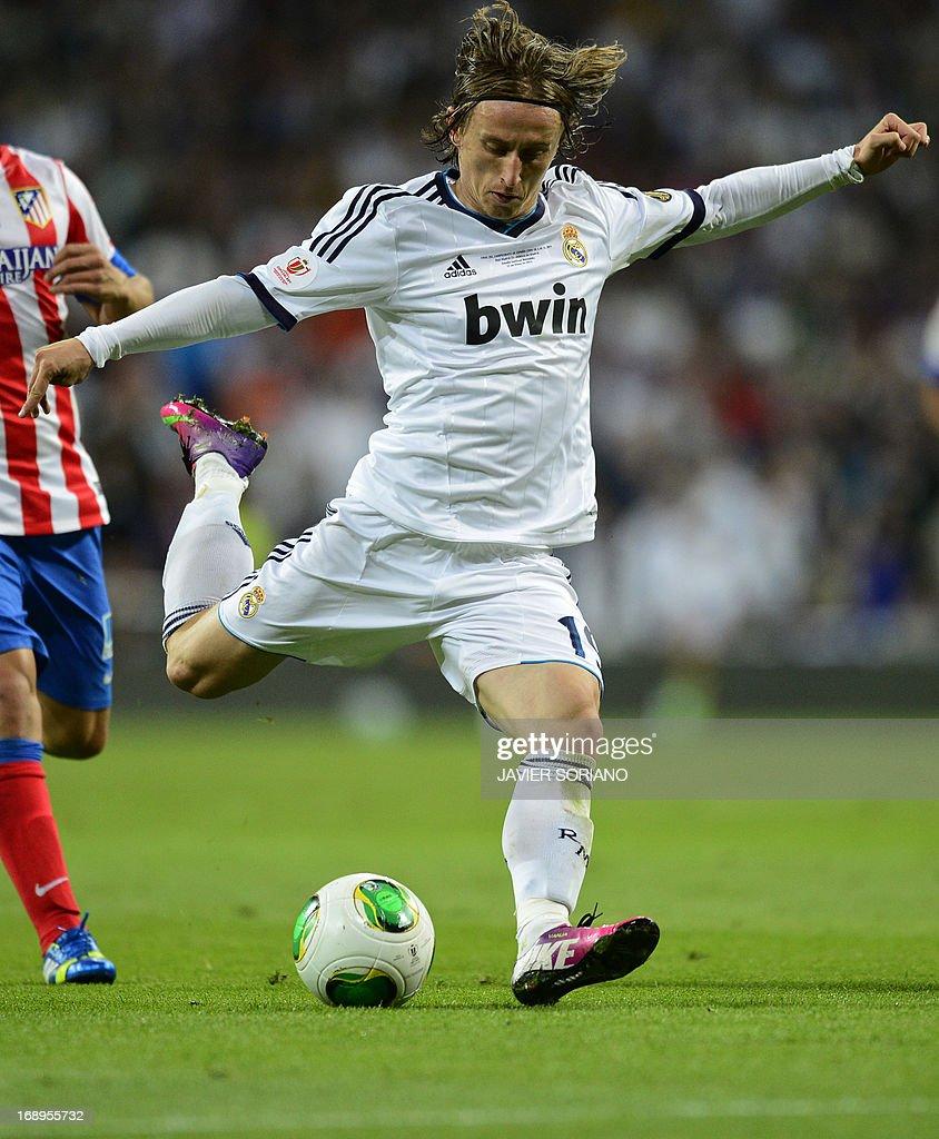 Real Madrid s Croatian midfielder Luka Modric kicks the ball