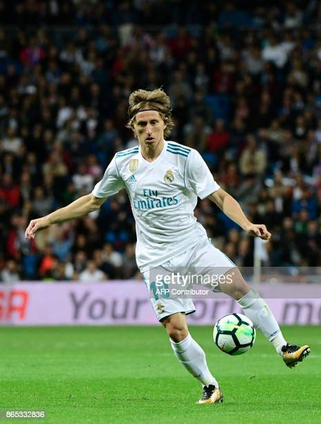 Real Madrid's Croatian midfielder Luka Modric kicks the ball during the Spanish league football match Real Madrid CF vs SD Eibar at the Santiago...