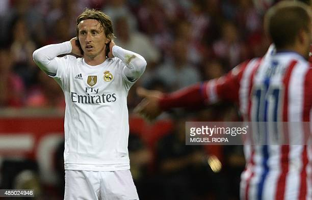 Real Madrid's Croatian midfielder Luka Modric reacts during the Spanish league football match Sporting Gijon vs Real Madrid CF at the El Molinon...