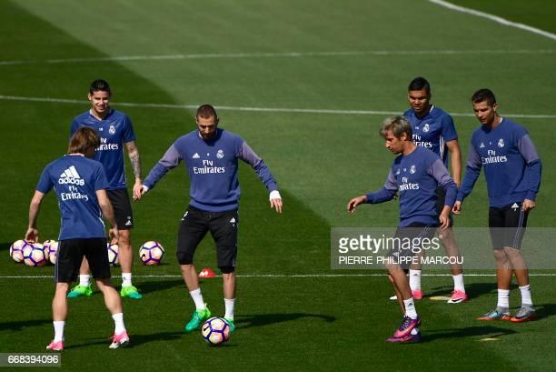 Real Madrid's Croatian midfielder Luka Modric Real Madrid's Colombian midfielder James Rodriguez Real Madrid's French forward Karim Benzema Real...
