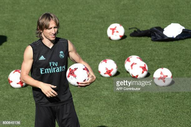 Real Madrid's Croatian midfielder Luka Modric takes part in a training session at Real Madrid sport city in Madrid on August 12 on the eve of the...