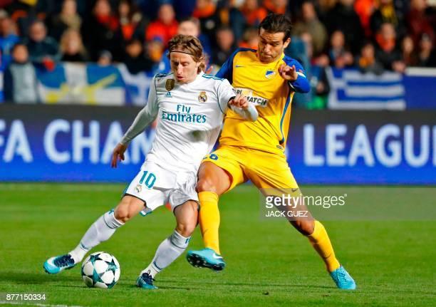 Real Madrid's Croatian midfielder Luka Modric vies for the ball agaisnt Apoel's Portuguese midfielder Nuno Morais during the UEFA Champions League...