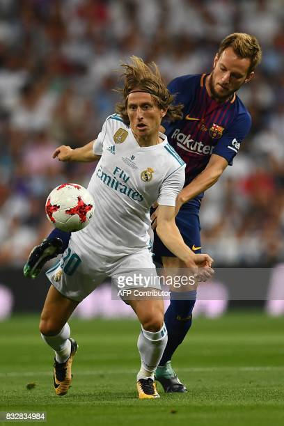 Real Madrid's Croatian midfielder Luka Modric vies with Barcelona's Croatian midfielder Ivan Rakitic during the second leg of the Spanish Supercup...