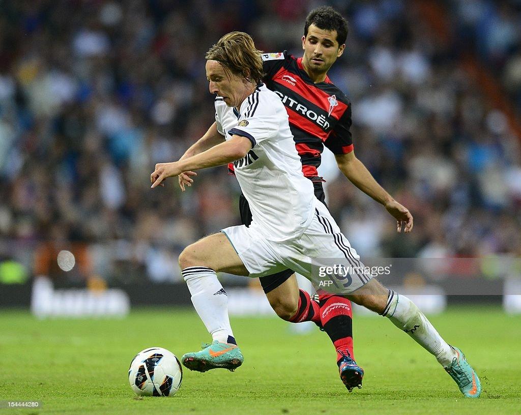 Real Madrid s Croatian midfielder Luka Modric L vies with