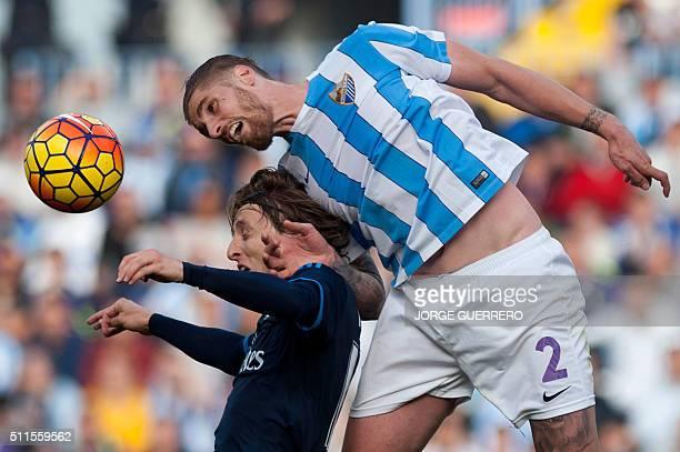 Real Madrid's Croatian midfielder Luka Modric vies with Malaga's defender Raul Albentosa during the Spanish league football match Malaga CF vs Real...