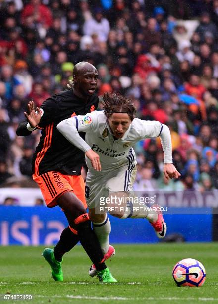 Real Madrid's Croatian midfielder Luka Modric vies with Valencia's French defender Eliaquim Mangala during the Spanish league football match Real...