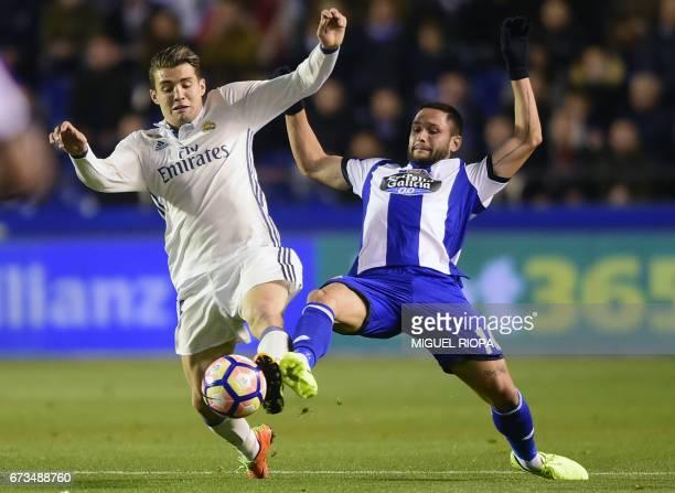 Real Madrid's Croatian midfielder Mateo Kovacic vies with Deportivo La Coruna's Romanian forward Florin Andone during the Spanish league football...