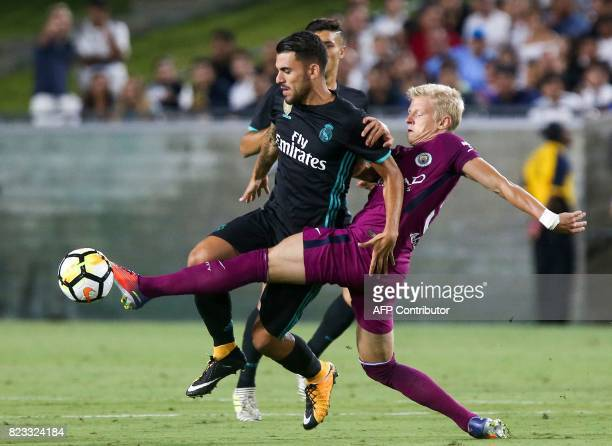 Real Madrid's Dani Ceballos and Manchester City's Oleksandr Zinchenko fight for the ball during the International Champions Cup football match in Los...