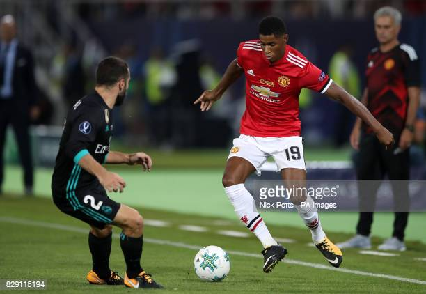 Real Madrid's Daniel Carvajal and Manchester United's Marcus Rashford battle for the ball