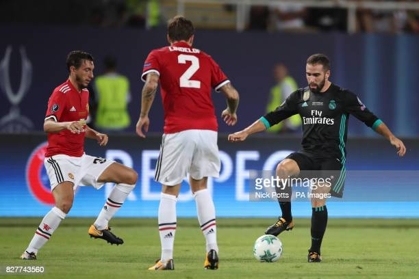 Real Madrid's Daniel Carvajal and Manchester United's Matteo Darmian battle for the ball during the UEFA Super Cup match at the Philip II Arena...